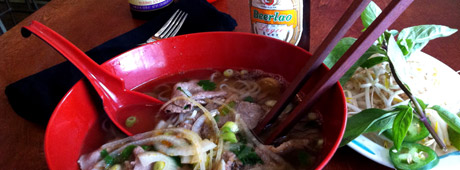 A bowl of pho with fixings
